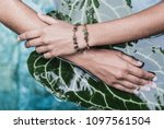 female hands on tropical leaves ... | Shutterstock . vector #1097561504