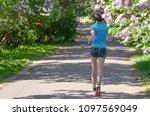 woman runner jogging in spring...   Shutterstock . vector #1097569049