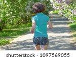 woman runner jogging in spring...   Shutterstock . vector #1097569055