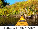 bow of yellow kayak against the ... | Shutterstock . vector #1097577029