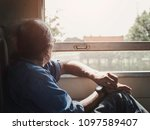 Old Man Sitting Beside The...