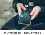 phone with cracked screen in hand. non warranty case - stock photo