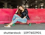 young cheerful woman in fashion ... | Shutterstock . vector #1097602901