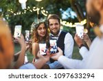 guests with smartphones taking... | Shutterstock . vector #1097633294