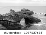 Small photo of Biarritz (France). Tourists discover the Rock of the Blessed Virgin. Black and white photo.