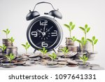 clock and rows of coins for...   Shutterstock . vector #1097641331