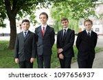 happy schoolchildren sit at a... | Shutterstock . vector #1097656937
