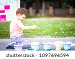 small child playing with... | Shutterstock . vector #1097696594