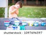pretty boy on the ground... | Shutterstock . vector #1097696597