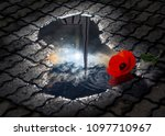 Tsitsernakaberd memorial monument of the Armenian Genocide and the sun with the dramatic clouds are reflected in a puddle with the red poppy in it, Yerevan, Armenia