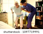 nurse helping senior woman to... | Shutterstock . vector #1097719991
