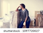black woman moving furniture | Shutterstock . vector #1097720027