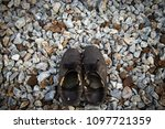 old shoes on stone background ...   Shutterstock . vector #1097721359