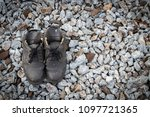 old shoes on stone background ...   Shutterstock . vector #1097721365