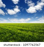 green field and blue sky with... | Shutterstock . vector #1097762567