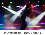 dancing silhouette of girl in a ... | Shutterstock . vector #1097778641