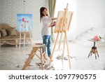 ute girl artist paints on... | Shutterstock . vector #1097790575