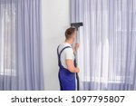 male worker removing dust from...   Shutterstock . vector #1097795807