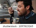 homeless and poor. guy is... | Shutterstock . vector #1097815265