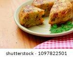portion of spanish potatoes... | Shutterstock . vector #1097822501