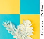 Small photo of White painted tropical and palm leaves in vibrant bold vivid colors. Concept art. Minimal summer background. Flat lay.
