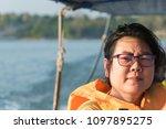 asian woman sailing on... | Shutterstock . vector #1097895275