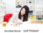 attractive asian woman studying ... | Shutterstock . vector #109790069