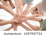 people putting hands together... | Shutterstock . vector #1097937731