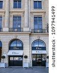 Small photo of PARIS, FRANCE - APRIL 8, 2017: Place Vendome (1702), in centre Column of Vendome. Place Vendome serves today for prestigious establishments: Ritz hotel, Cartier, Rolex, Dior, Chanel, jewelers stores.