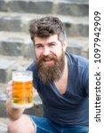 bearded hipster holds beer mug  ... | Shutterstock . vector #1097942909