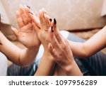 the sisters touching fingers to ... | Shutterstock . vector #1097956289