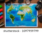 world map on a wooden table top ... | Shutterstock . vector #1097959799