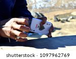 Small photo of India - 02/2018 Man shuffling playing cards