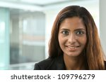 Portrait of a happy Indian business woman. - stock photo
