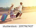 happy young couple landed at... | Shutterstock . vector #1097967437
