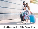 young couple travelers with... | Shutterstock . vector #1097967455