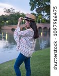 asian woman tourists. he is... | Shutterstock . vector #1097986475