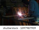 welding. a welder arc welds... | Shutterstock . vector #1097987909