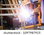 welding. a welder arc welds... | Shutterstock . vector #1097987915