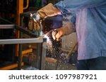 welding. a welder arc welds... | Shutterstock . vector #1097987921
