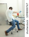 dentist stretching arms in his... | Shutterstock . vector #1098000767