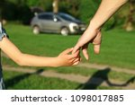 the parent holds the hand of a... | Shutterstock . vector #1098017885