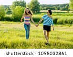 parent and teenager  happy... | Shutterstock . vector #1098032861