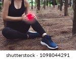 sport woman injury at knee...   Shutterstock . vector #1098044291