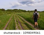 young man travels alone on... | Shutterstock . vector #1098049061