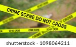 Small photo of murder, kill and people concept - blurred dead man body in field and police tape at crime scene