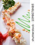 fresh crab leg served with... | Shutterstock . vector #1098078485