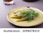 sliced pickled cucumbers served ... | Shutterstock . vector #1098078515