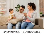 family  parenthood and people... | Shutterstock . vector #1098079361