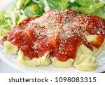 cheese filled ravioli with... | Shutterstock . vector #1098083315